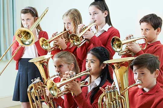 Class having trumpet music lesson