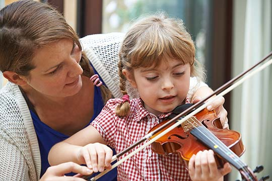 Child having violin tuition